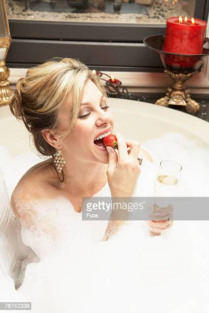 Wealthy Woman Eating Strawberry in Bubble Bath