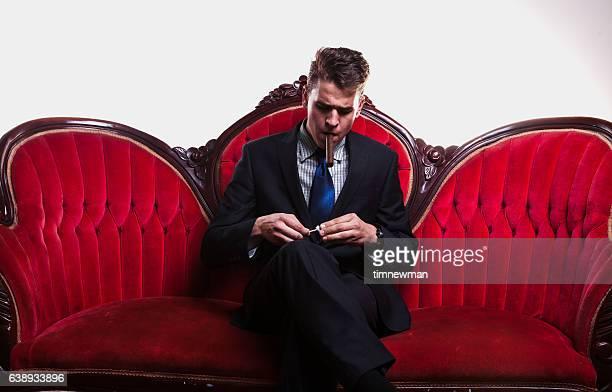 Wealthy Young Man Smoking Cigar