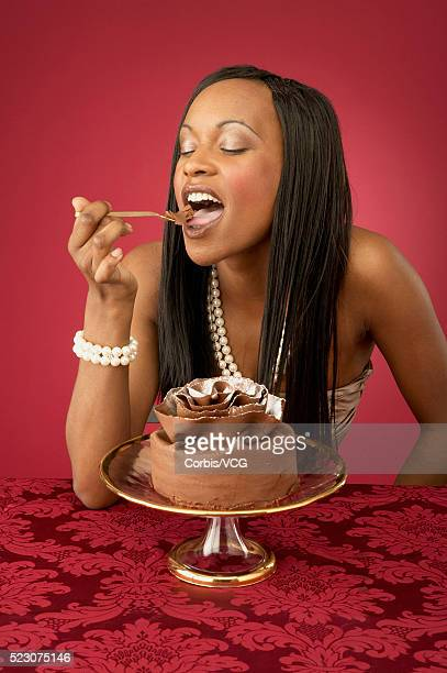 Wealthy Young Woman Eating Chocolate Dessert