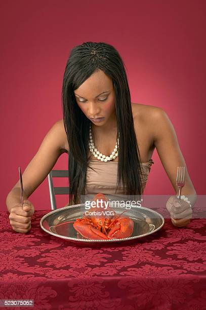 Wealthy Young Woman Eating Lobster
