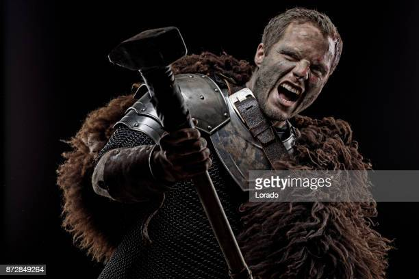 weapon wielding dirty bloody viking warrior in emotional pose - barbarian stock photos and pictures