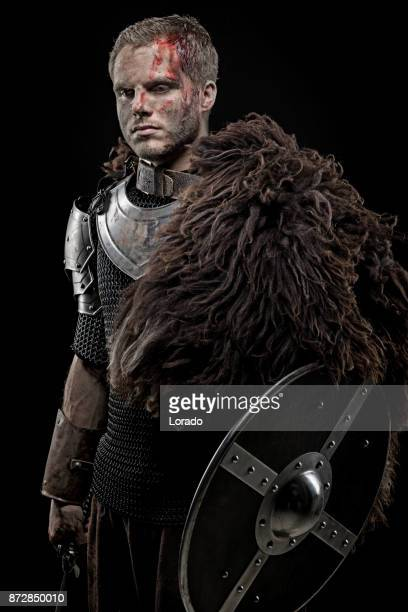 Weapon wielding dirty bloody viking warrior in emotional pose
