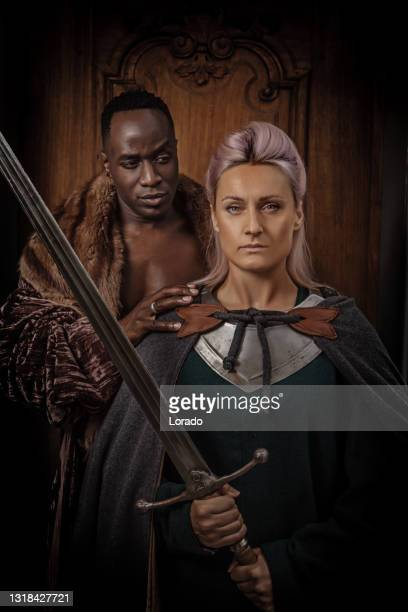 weapon wielding viking inspired black african warrior and viking woman - historical clothing stock pictures, royalty-free photos & images