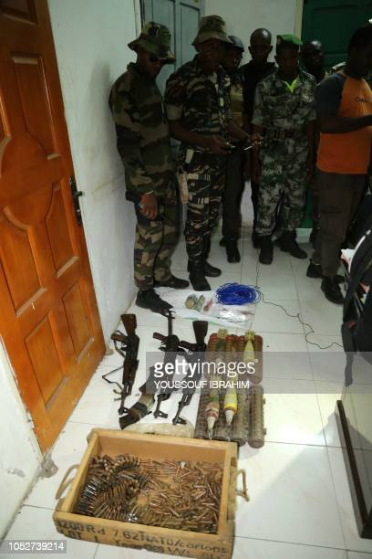 Weapons and ammunitions seized by the Comoros Armed forces in the Medina are displayed at the Prosecutor office in Mutsamudu on October 22 2018 in...