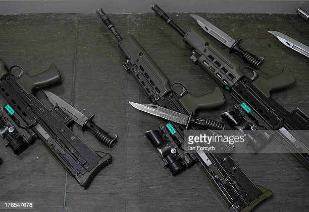 Weapons and bayonets are laid out on the floor before being carried at a graduation parade for Junior Soldiers on August 15 2013 in Harrogate England...