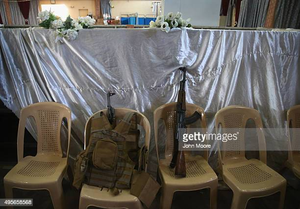 Weapons and body armor sit in a wedding hall now used as a military hospital on November 4, 2015 near the frontline with ISIS fighters in Telskuf,...