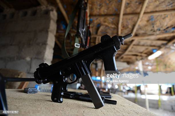 Weapons are seen at the Arbil Gun Bazaar in Kasnazan near the Arbil Iraq on August 20 2014 Dealers say that sales of weapons at the market have...