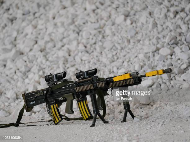 Weapons fitted with blank firing attachments are placed to one side as their owners prepare a model ahead of an Orders Group as troops from 4...