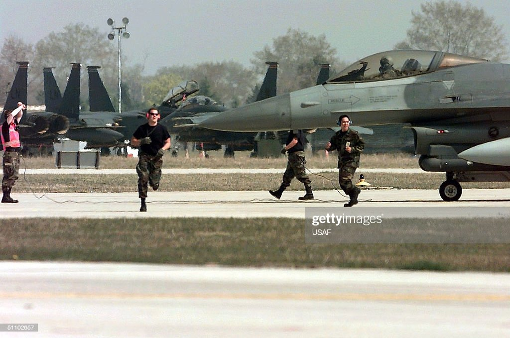 Weapons Loaders From The 555Th Fighter Squadron Aviano Air Base Italy Prepare To Launch Their F 1 : News Photo