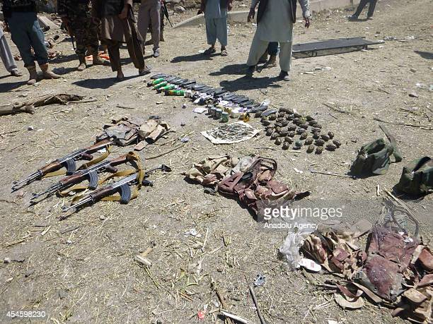 Weapons of Taliban militants are seen at the site of attack in Ghazni Afghanistan on September 4 2014 Bombing and armed Taliban attacks on a...