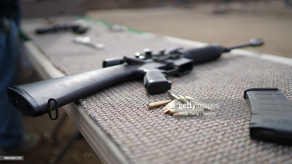 Weapons On Table : Stock Photo