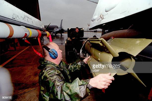 A weapons tecnician loads missiles on a F16 to prepare it for the next sortie in support to NATO in the Operation ALLIED FORCE March 27 1999