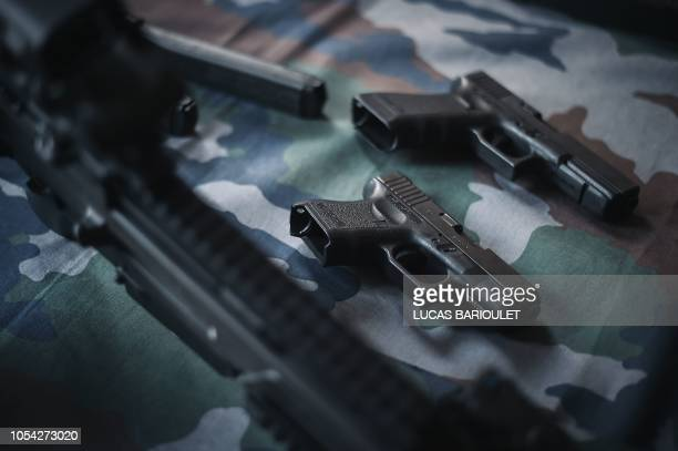 Weapons used by the Research Assistance Intervention Deterrence Police Unit is displayed during the visit of French Interior Minister in the...