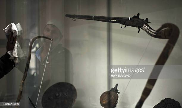 Weapons used for hunting between the 18th and 19th century sit on display in a cabinet at the National Museum of Afghanistan in Kabul on April 30...