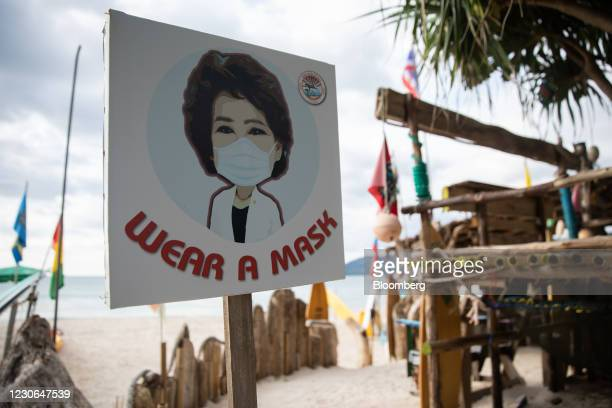 Wear A Mask' sign at Patong Beach in Patong, Phuket, Thailand, on Saturday, Dec. 19, 2020. The tepid response to Thailands highly publicized...