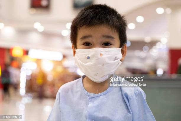 wear a mask to protect from the corona virus.,prevent pollution,pollution - scuba mask stock pictures, royalty-free photos & images