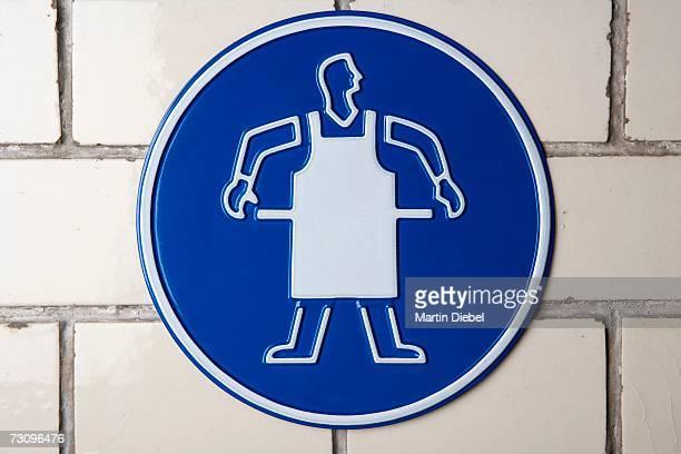 ?Wear apron? caution sign
