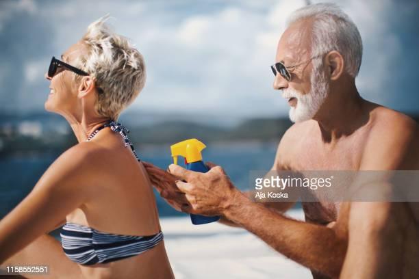 wear sunscreen and protect your skin. - homem moreno imagens e fotografias de stock