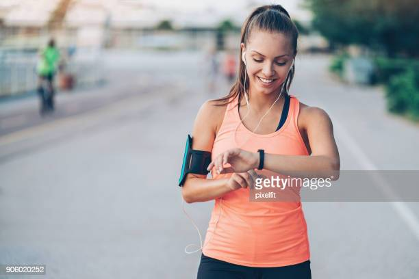 wearable tech - running stock pictures, royalty-free photos & images