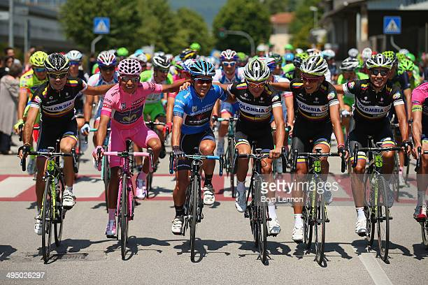 Wearer of the Maglia Rosa leader's jersey Nairo Alexander Quintana Rojas of Colombia and Movistar is seen with Colombia Team riders during the...