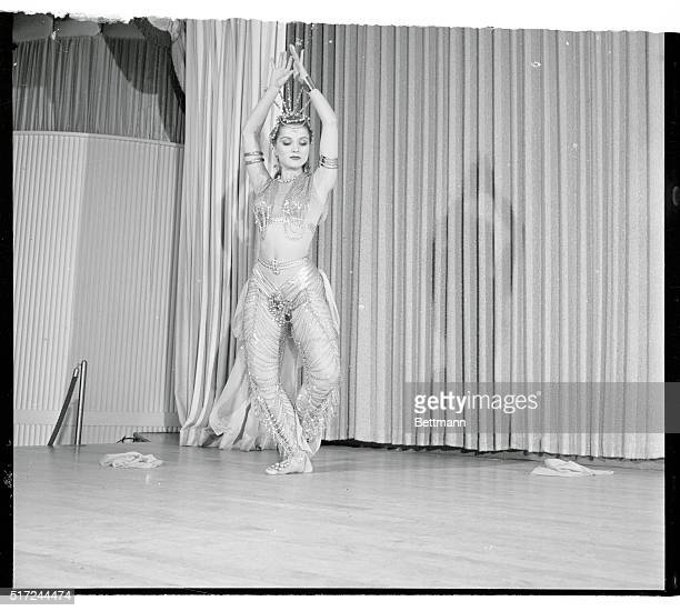 Wearing a 60 pound gold chain costume on her 110 pound body, actress Debra Paget prepares for her opening at a Las Vegas nightclub. She will perform...