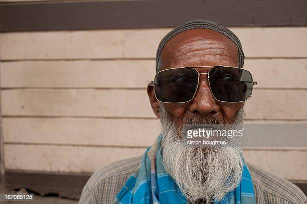 CONTENT] Wearing a beard and cap and very large pair of retro sunglasses this in Kolkata West Bengal 2012