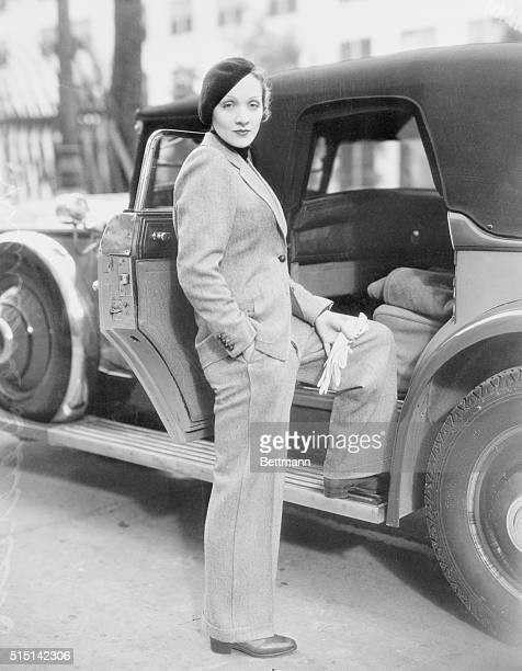 Wearing a beret and carrying gloves Marlene Dietrich prominent Paramount screen star jauntily strolls along Hollywood Street attired in a grey man's...