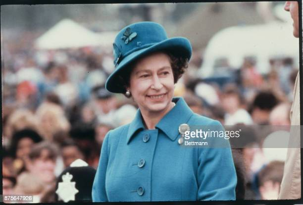 Wearing a blue hat and matching coat Queen Elizabeth II of England is married to Philip Mountbatten now Prince Philip The Duke of Edinburgh and is...