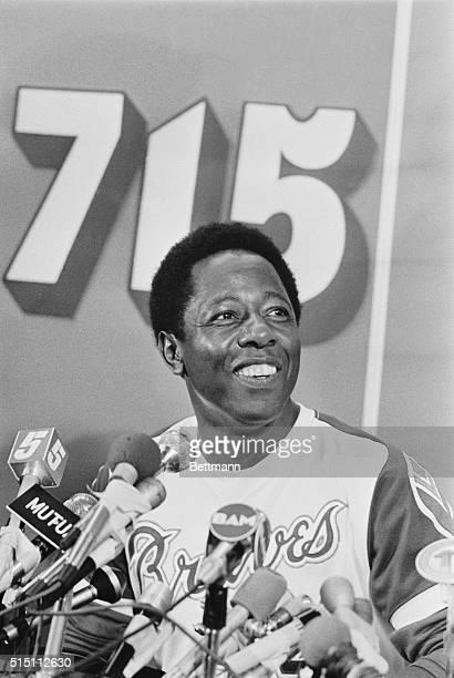 Wearing a broad smile Hank Aaron describes his 715th home run during a news conference following the game Aaron broke Babe Ruth's old record of 714...