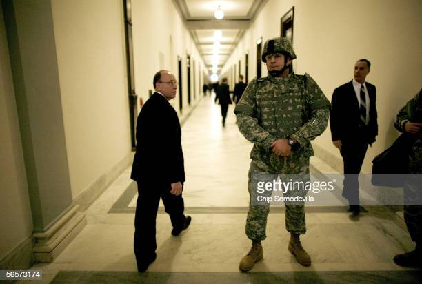 Wearing a complete set of U.S. Army body armor, Maj. Greg Paul of Cincinnati, Ohio, draws glances as he waits in the hallway of the Russell Senate...