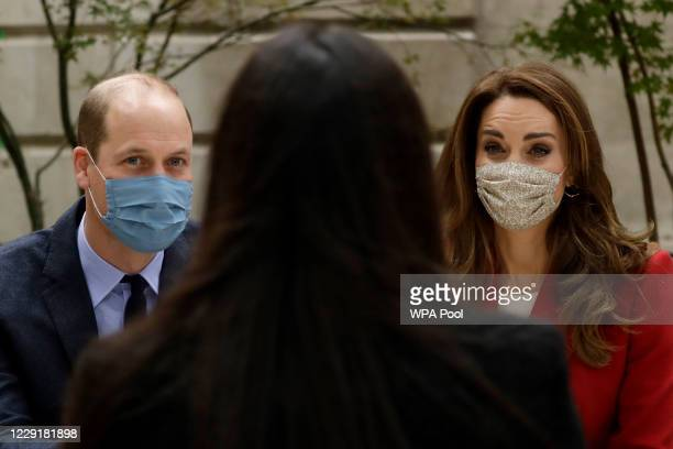 Wearing a face covering to curb the spread of coronavirus Catherine Duchess of Cambridge meets pharmacy technician Amelia Chowdhury as she and Prince...