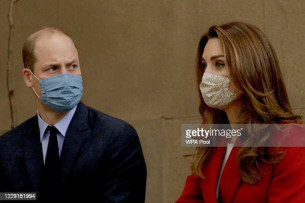 Wearing a face covering to curb the spread of coronavirus Catherine Duchess of Cambridge meets medical staff as she and Prince William visit St...