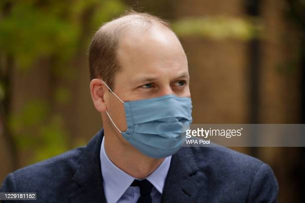 Wearing a face covering to curb the spread of coronavirus Prince William Duke of Cambridge meets pharmacist Joyce Duah as he and Catherine Duchess of...