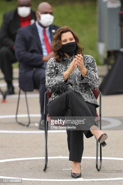 Wearing a face mask to reduce the risk posed by coronavirus, Michigan Governor Gretchen Whitmer applauds for Democratic presidential nominee and...