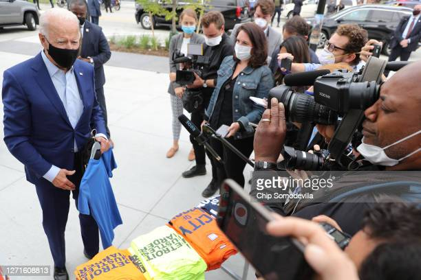 Wearing a face mask to reduce the risk posed by the coronavirus, Democratic presidential nominee Joe Biden talks briefly to journalists while...