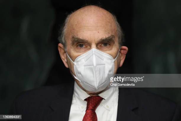 Wearing a face mask to reduce the risk posed by the novel coronavirus State Department Special Representative for Venezuela Elliot Abrams prepares to...