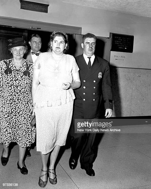 Wearing a gray silk polka dot dress and sporting a new hairdo Martha Beck leaves Bronx Courthouse for Sing Sing Prison after being sentenced to the...