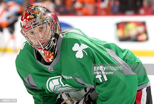 Wearing a green jersey in honor of St Patrick's Day Craig Anderson of the Ottawa Senators warms up prior to a game against the Philadelphia Flyers at...