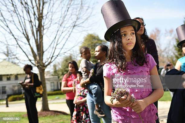 Wearing a hat that was inspired by the one that President Abraham Lincoln wore Dina Gutierrez attends an event at Lincoln's Cottage to commemorate...