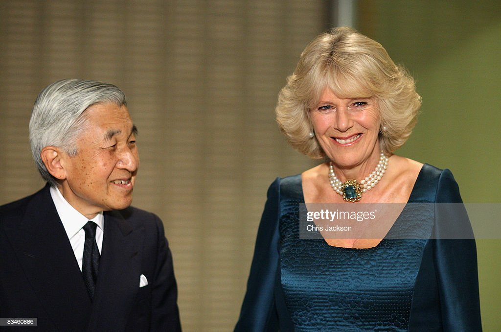Wearing a Japanese influenced dress HRH Camilla, Duchess of Cornwall walks stands next to Emperor Akihito as they arrive for a private dinner at the Imperial Palace on October 28, 2008 in Tokyo, Japan. Prince Charles, Prince of Wales and Camilla, Duchess of Cornwall are in Japan as part of a ten day tour of East Asia that takes in Japan, Brunei and Indonesia.