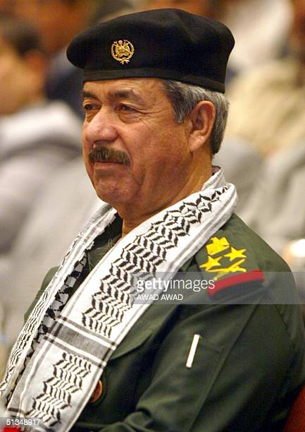 Wearing a Palestinian scarf around his neck on the second anniversary of the Palestinian uprising against Israeli occupation Ali Hassan alMajid a...