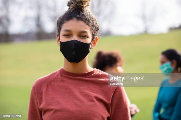 wearing a protective face mask - flatten the curve stock pictures, royalty-free photos & images