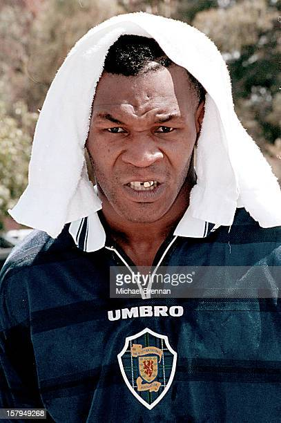 Wearing a Scottish Football Association shirt boxer Mike Tyson emerges from a training session in Phoenix Arizona 9th June 2000 He is scheduled to...