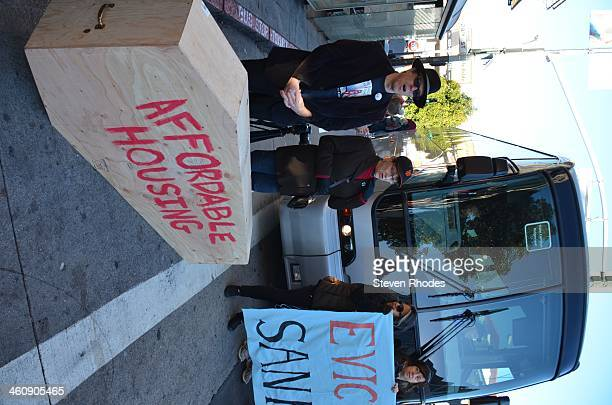 Wearing a SF Giants cap, Patricia Kerman who is facing an Ellis Act eviction from her home of 27 years stands behind an 'Affordable housing' coffin...
