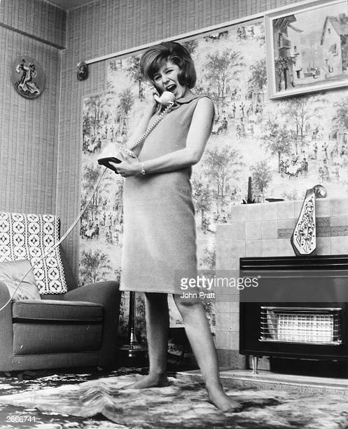 Wearing a shiftdress Beatles fan 16 year old Marilyn Powell of Walworth south London She works in a shoe shop during the day practises singing at...
