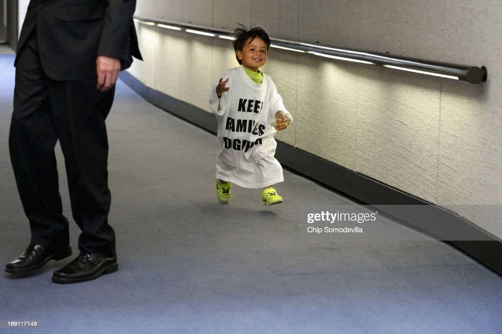 Wearing a shirt that reads 'Keep Families Together,' 2-year-old U.S. citizen Eric Lopez of Richfield, Minnesota, runs thorugh the hallway outside the Senate Judiciary Committee's markup session for the immigration reform legislation in the Hart Senate Office Building on Capitol Hill May 20, 2013 in Washington, DC. Lopez's father was departed to Mexico when his mother was six months pregnant and living in a shelter. The Judiciary Committee is hoping to wrap up work on the landmark immigration reform bill this week after wading through the 300 amendments that were filed to the bipartisan bill.
