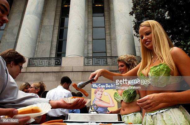 Wearing a skimpy bikini made of lettuce leaves, Playboy magazine's Miss July 2002, Lauren Anderson serves up some veggie-dog's to staffers in front...