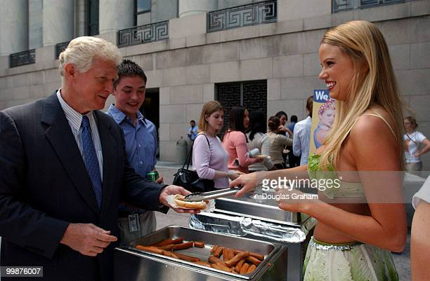 Wearing a skimpy bikini made of lettuce leaves, Playboy magazine's Miss July 2002, Lauren Anderson serves up a veggie-dog to Jim Moran, R-VA, in...
