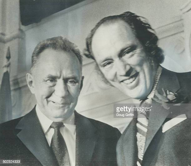 Wearing a smileandahalf a full one on the face of Prime Minister Pierre Trudeau a half smile on the face of Soviet Premier Alexei Kosygin the two...
