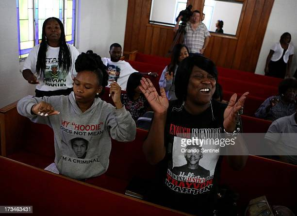 Wearing a Trayvon Martin hoodie and shirt Nysha King left and Nichole Mitchell dance with other church members at St Paul Missionary Baptist Church...